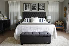 master bedroom with thick white mattress matching black tufted