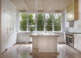 the kitchen s focal point is the custom brass vent hood ceilings the kitchen s focal point is the custom brass vent hood ceilings are white oak with