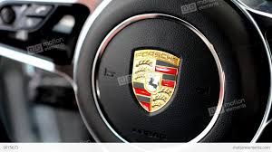 porsche turbo logo detail of logo wheel porsche interior suv macan turbo stock