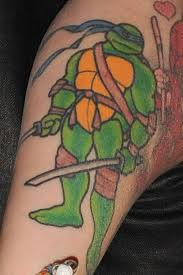 ninja turtles tattoos on right biceps
