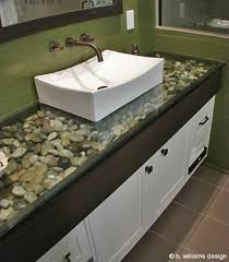 bathroom ideas river rock under glass countertop