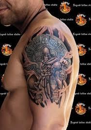 fantastic aztec warrior tattoo on biceps