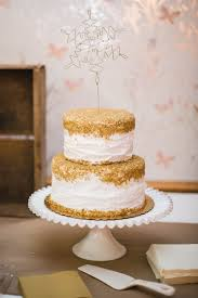 wedding cake buttercream gold topped white buttercream wedding cake happily after