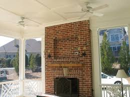 brick outdoor fireplace on screened porch archadeck outdoor living