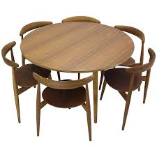 hans wegner round dining table and matching heart shaped chairs