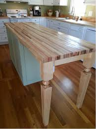 striking wooden kitchen island legs with custom butcher block