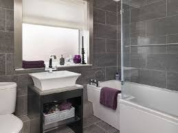 bathroom tiling idea same tile floor and wall the brushed steel window trim to