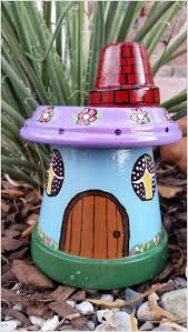 Pinterest Gardening Crafts - garden gnome house made from clay pots these are awesome garden
