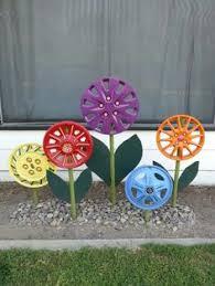 Diy Garden Crafts - a diy hubcap flower garden can brighten up any yard pick up old