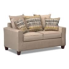 bryden sofa and loveseat set beige value city furniture
