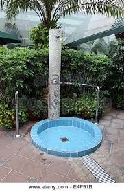 Outdoor Pool Showers - outdoor swimming pool shower tap close up stock photo royalty