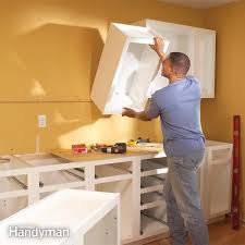 how to hang a cabinet to the wall how to install kitchen cabinets diy family handyman