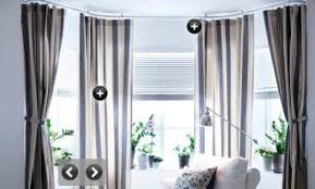 Hang Curtains From Ceiling Designs Hang Curtains From Ceiling Or Below Border Apartment Therapy