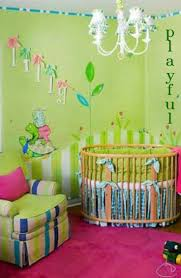 Nursery Decoration Ideas by Bedroom Wooden Round Cribs With White Chandelier And Armchair For