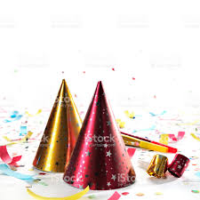 new years party blowers party hats whistles horns confetti isolated on white studio