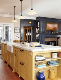 bronze faucets for kitchen kitchen pastel yellow island with brick exposed fireplace also
