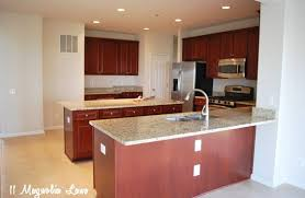 kitchen cabinets that look like furniture how to paint your kitchen cabinets for a smooth painted finish 11