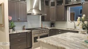 dark wood cabinets with a blue kitchen island omega ultima gray cabinets with an off white kitchen island