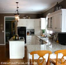 how to decorate space above kitchen cabinets that space above the cabinets creating this
