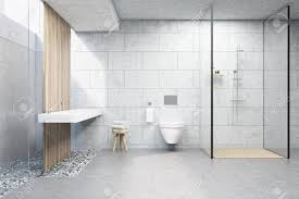 bathroom interior with gray brick walls a shower cabin with