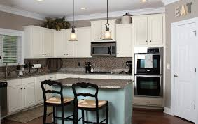 u shaped white kitchen cabinets with grey glaze microwave oven