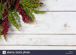 garland with pine cones and berries on a white wood