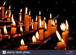 vigil lights catholic church burning prayer candles in a catholic church in europe stock photo