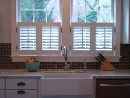 kitchen window covering ideas café style shutters cover half of the window offering privacy