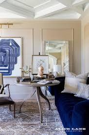 royal blue velvet tufted sofa with blue metallic pillow