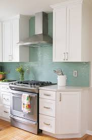white kitchen cabinets with aqua backsplash welcome to the mouse house modern kitchen renovation