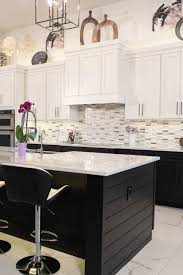 two tone kitchen cabinets and island an shiplap island both grounds and adds style to this