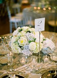 white rose and blue hydrangea centerpiece blue hydrangea