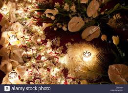white flowers lit by candles and small electric lights at a stock