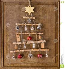 tree made from sticks and ornaments stock photo image