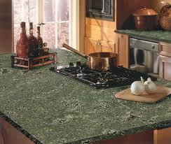 granite countertop floor to ceiling cabinets kitchen range hood
