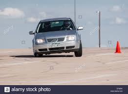 volkswagen jetta sports car a 2004 gray volkswagen jetta automobile in an autocross race at a