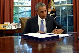 obama at desk obama executive orders regulations pardons expected as presidency