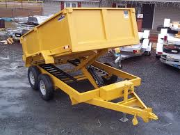7 x 12 12k dump trailer with equipment ramps and 3ft sides dump