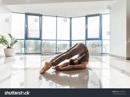 man training yoga on reflection floor stock photo 415277047 man training yoga on the reflection floor at the studio in front of a window