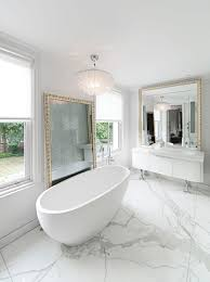 bath freestanding on bookmatched calacatta oro marble floor ab