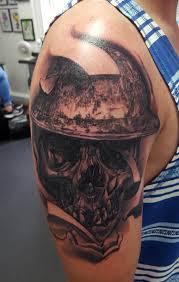 war themed skull by alan aldred tattoos