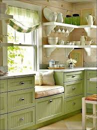 farmhouse kitchen in green loving the window seat country