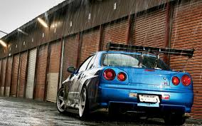 skyline nissan r34 blue nissan skyline gtr r34 in the rain wallpapers and images