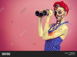 halloween background pink portrait of a pin up zombie woman looking through binoculars pink