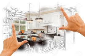 female hands framing custom kitchen design drawing and photo