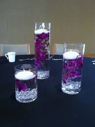 Purple Floating Candles For Centerpieces by Floating Candles Rise Above Floral Decor For Your Centerpieces