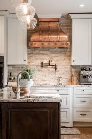 57 best my copper kitchen images on pinterest kitchen ideas love the copper vent hood pin 1 this is such a beautiful kitchen love the mis matched hardware finishes the copper in the room with the stone splashback