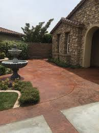 is it better to paint or stain your kitchen cabinets which is better for coloring a concrete patio paint epoxy