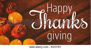 thanksgiving greeting text against candies with small pumpkins on