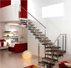 modern house with red accents and stainless steel stair railing